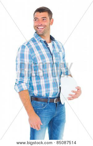 Smiling handyman with hardhat looking away on white background