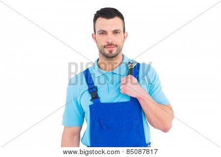 Repairman holding adjustable wrench on white background