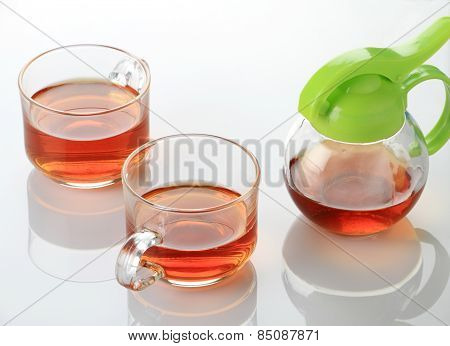 Two Tea Cup And Kettle In White Reflective Background