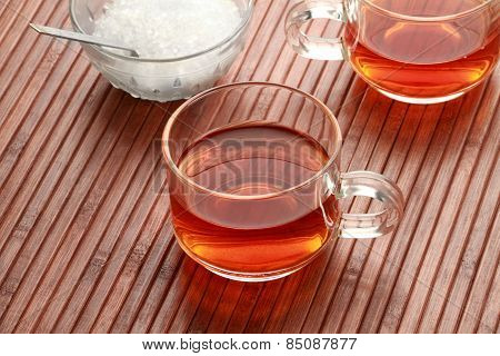 Tea Cup And Sugar In Wooden Background