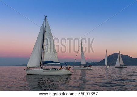 PATRAS, GREECE - CIRCA OCT, 2014: Unidentified sailboats participate in sailing regatta 12th Ellada Autumn 2014 among Greek island group in the Aegean Sea, in Cyclades and Argo-Saronic Gulf.