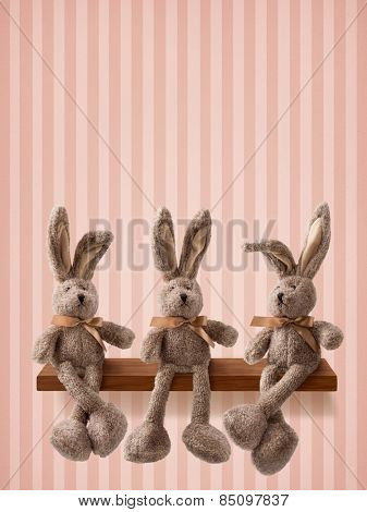Three hares sitting on the shelf