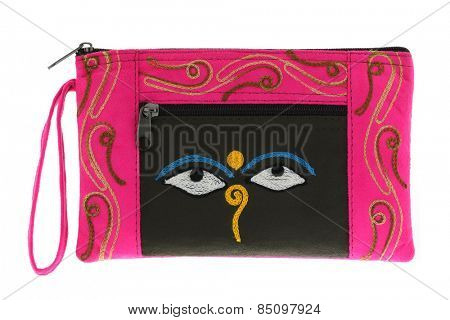 A small pink bag with symbol Nepali Buddha Eyes, common souvenir from Nepal