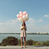 stock photo of legs air  - Fashion girl with  air balloons over blue sky - JPG