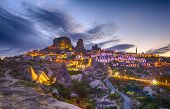 stock photo of chimney rock  - Ancient town and a castle of Uchisar dug from a mountains after twilight - JPG