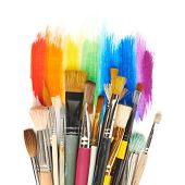 image of bristle brush  - Pile of the multiple different brushes over the rainbow gradient paint strokes - JPG