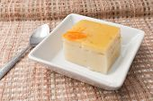 pic of custard  - Coconut custard made from eggs and coconut milk in white bowl on Fabric - JPG