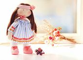 picture of rag-doll  - Handmade doll near window close - JPG