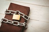 image of pentecostal  - Open bible chained with lock on wooden table - JPG