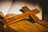 stock photo of crucifix  - Open bible with crucifix icon on wooden table - JPG
