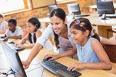 picture of teachers  - Cute pupils in computer class with teacher at the elementary school - JPG