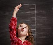 stock photo of blackboard  - beauty child at the blackboard - JPG