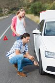 foto of breakdown  - Couple after a car breakdown at the side of the road - JPG