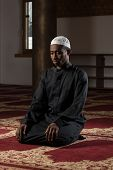 picture of god  - African Muslim Man Making Traditional Prayer To God While Wearing A Traditional Cap Dishdasha - JPG