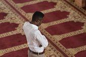pic of muslim man  - Black African Muslim Man Is Praying In The Mosque - JPG
