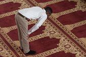 image of muslim man  - Black African Muslim Man Is Praying In The Mosque - JPG