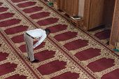 picture of muslim man  - Black African Muslim Man Is Praying In The Mosque - JPG