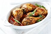 stock photo of roast chicken  - Oven roasted chicken legs with fresh rosemary - JPG