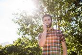 picture of electronic cigarette  - Hipster smoking an electronic cigarette on a summers day - JPG