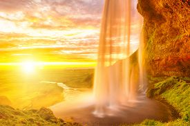 stock photo of incredible  - Seljalandsfoss is one of the most beautiful waterfalls on the Iceland - JPG