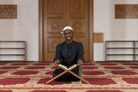 pic of islamic religious holy book  - Black African Muslim Man Reading Holy Islamic Book Koran - JPG