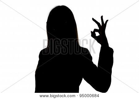 Silhouette woman with long hair showing okay