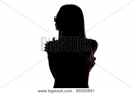Silhouette of hugging woman from back