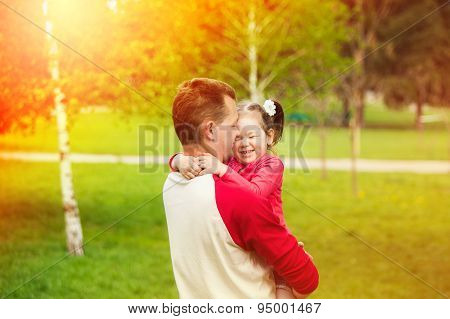 Happy Daddy With Daughter Playing In Summer Sunny Day