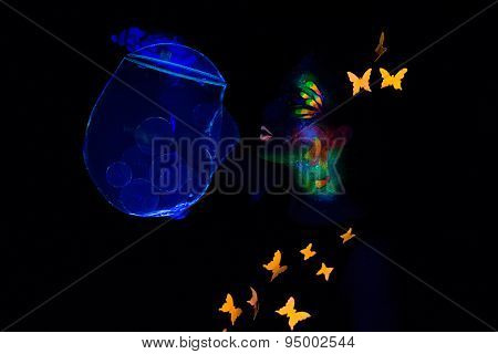 Photo woman blowing bubbles, luminous make up