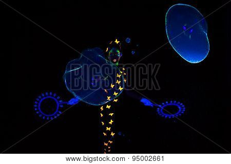 Image of woman with blue luminous bubbles