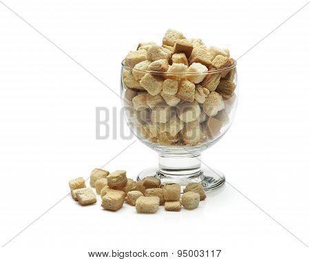 croutons in glass on white background