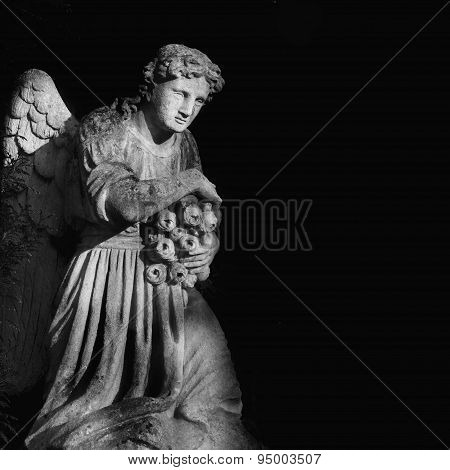 Sculpture Of An Angel In Black And White Colors