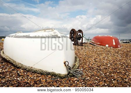 Two upturned row boats on the foreshore