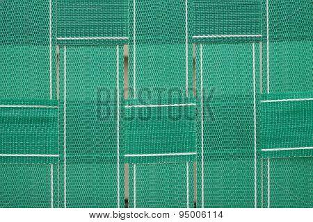 Green lawn chair webbing background