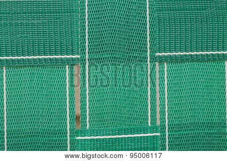 Close up of green lawn chair webbing background