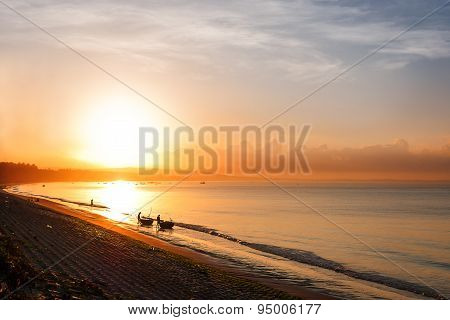Impressive Sunrise Near Mui Ne, Vietnam. Fishermen Preparing To Go Fishing.