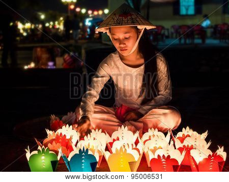Vietnamese Girl Selling Candle Offerings In Hoi An, Vietnam