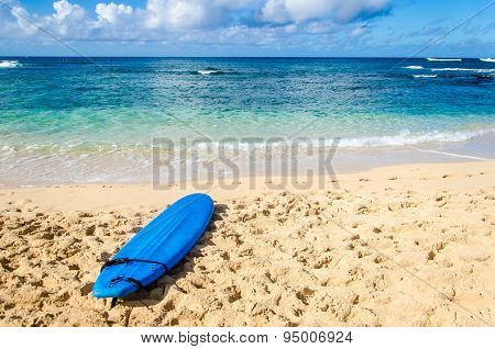 Surfboard On The Sandy Beach In Hawaii