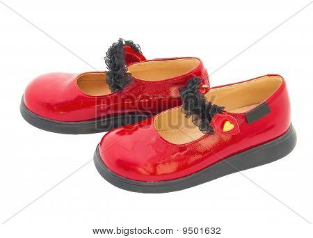 Red Patent Leather Baby Shoes With Black Tape. Isolated///