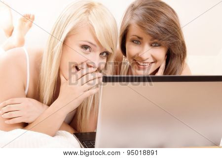 Two beautiful female friends gossiping