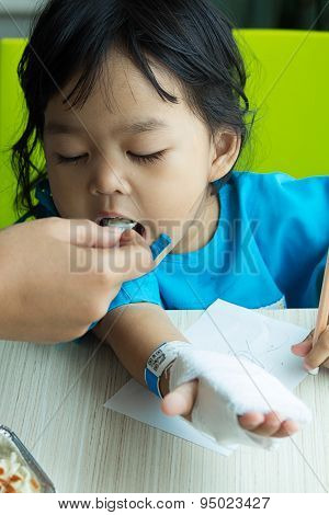 Illness Asian Kids Writing Paper On Desk And Eating Cereal, Saline Intravenous (iv) On Hand