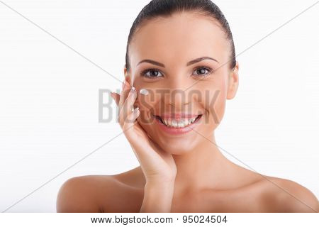 Beautiful young woman is enjoying skin care