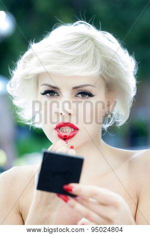 Sexy Blonde Put On Lipstick