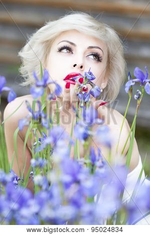 Portrait Of Lady With Iris Flowers