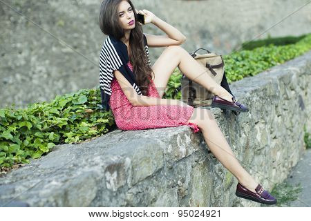 Beautiful Girl With Phone On Parapet