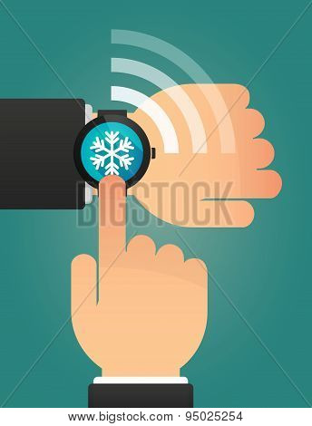 Hand Pointing A Smart Watch With A Snow Flake