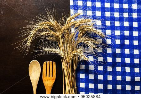 Wooden Table With Checked Tablecloth ,wooden Kitchen Utensils And Ears Of Wheat