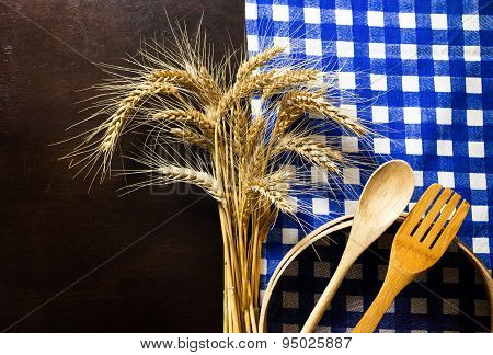 Wooden Table With Checked Tablecloth ,wooden Kitchen Utensils,ears Of Wheat And Wood Sieve