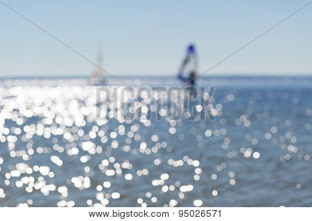 Defocused Seascape With Windsurfers On Sea Surface