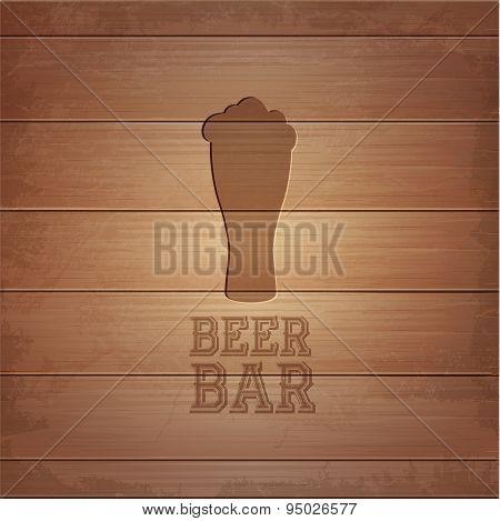 Silhouette Of Glass Of Beer On Wood Background